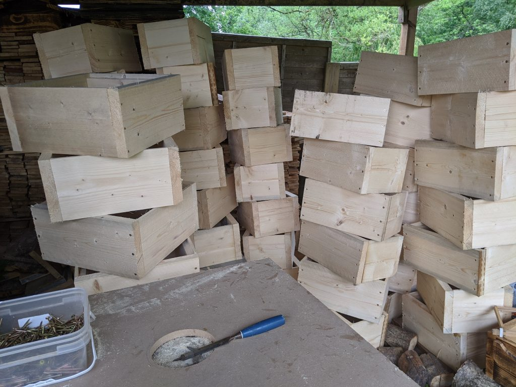 Some nucs and brood boxes under construction in an effort to replace the lost hives and bees.